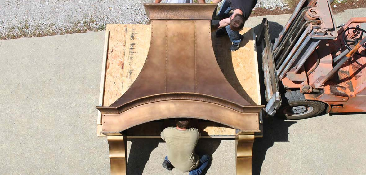 Photo of custom bronze range hood being loaded onto a palette.